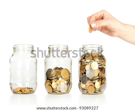 Glass banks for tips with money like diagram and hand isolated on white - stock photo
