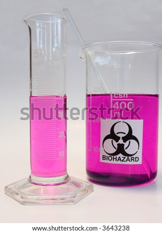 Glass beaker with biohazard sign and graduated cylinder filled with violet liquid - stock photo