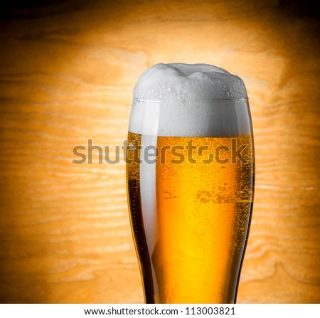 Glass beer on wood background