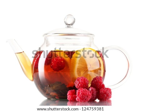 Glass black fruit tea in glass teapot isolated on white - stock photo
