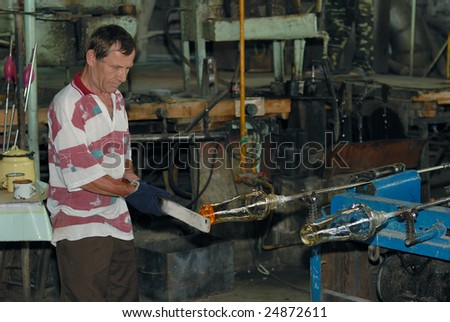 Glass blower on his work place