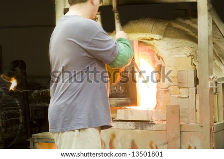Glass blowing - stock photo