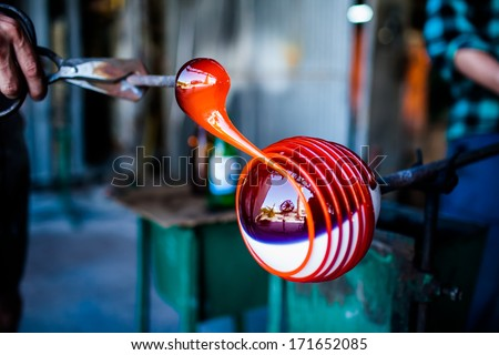 glass blowing and decorating, handmade - stock photo