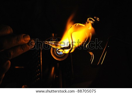 Glass-Blowing in the Dark - stock photo
