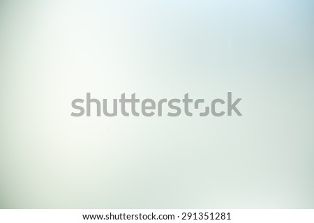 Glass Blurred Photo.Light gray abstract background. - stock photo