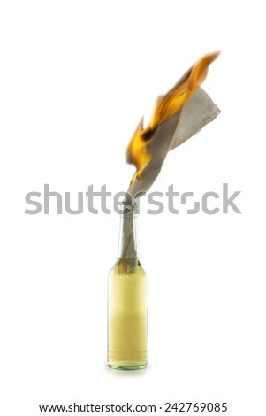 Glass bottle filled with gasoline, a so called Molotov Cocktail, with burning fuse isolated on white background - stock photo