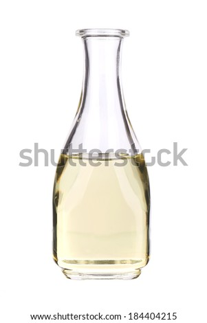 Glass bottle for oil or vinegar. Isolated on a white background. - stock photo