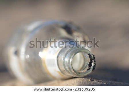 glass bottle in nature as garbage