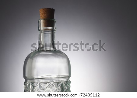 Glass bottle isolated on the background.
