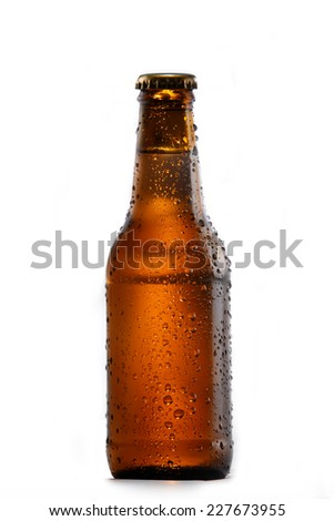 Glass bottle of cold beer on a white background. - stock photo