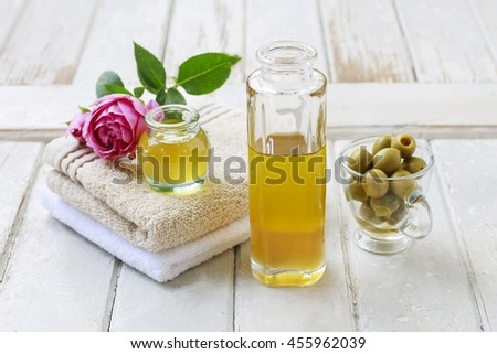 Glass bottle of golden oil on wooden background.  - stock photo