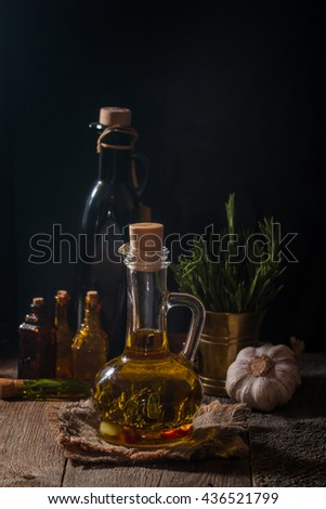 Glass bottle of olive oil with hrebs