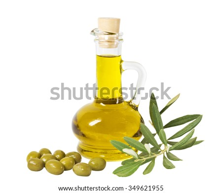 Glass bottle of premium olive oil and some olives with a branch isolated on white background - stock photo