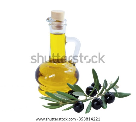 Glass bottle of premium olive oil and some ripe olives with a branch isolated on white background - stock photo