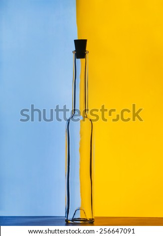glass bottle on color background - stock photo