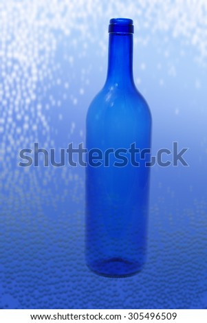 Glass Bottle on Textured Background - stock photo