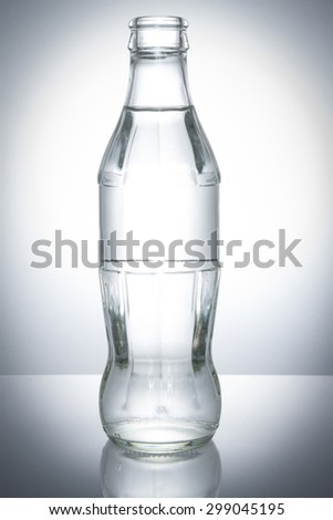 glass bottle on white background - stock photo