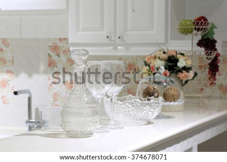 Glass bottle, Wine glass, glass bowl in beautiful sweet style decoration kitchen. - stock photo