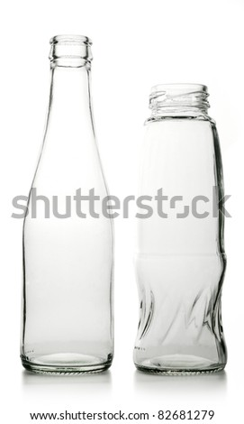 Glass bottle with a white liquid. The materials can be recycled again. - stock photo