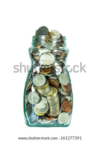 Glass bottle with coins on white background, savings concept - stock photo