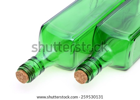 glass bottle with cork stopper on white background  - stock photo