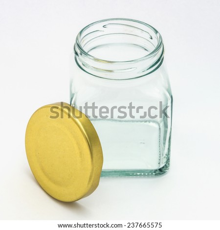 Glass bottle with gold lid isolated on white background - stock photo