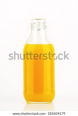 glass bottle with orange juice - stock photo