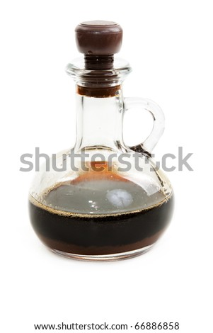 Glass bottle with soy sauce on white background - stock photo