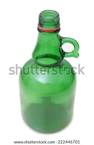 Glass bottle with whiskey on white background - stock photo