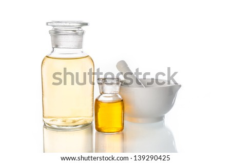 glass bottles and pestle used for herbal medicine - stock photo
