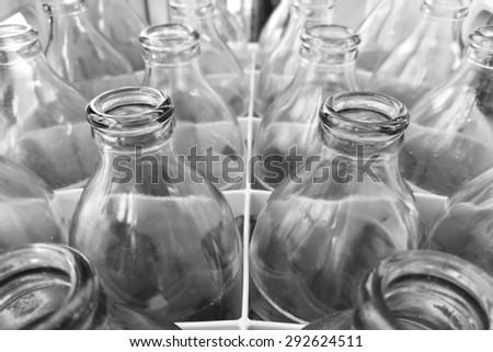 glass bottles in plastic crate - stock photo