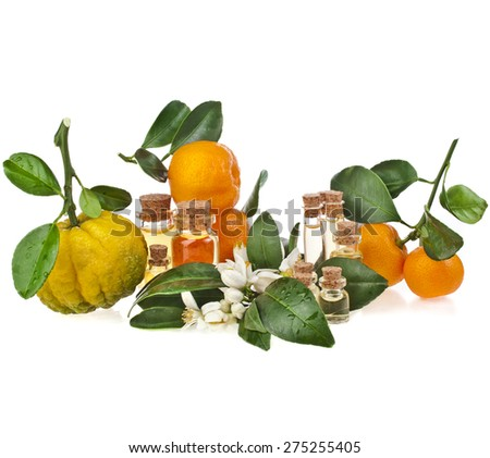 Glass bottles of herbal essences oil with fresh variety citrus  isolated on white background - stock photo