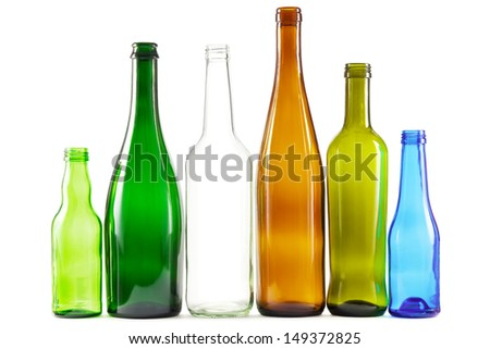 Glass bottles of mixed colors including green, clear white, brown and blue - stock photo