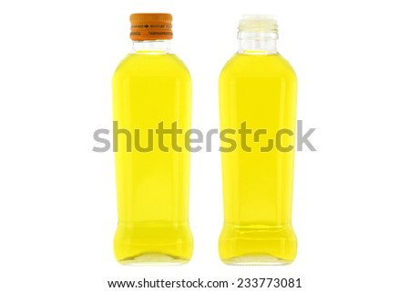 Glass bottles of Olive Oil with mild taste isolated on white background - stock photo