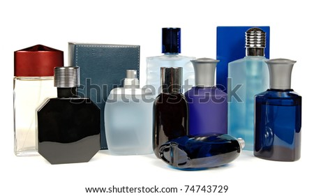 glass bottles of perfume isolated on a white background - stock photo