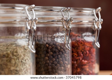 Glass Bottles of Various Cooking Spices - stock photo