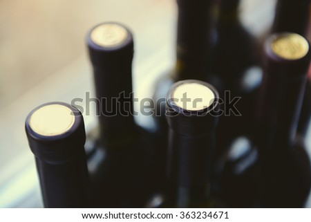 Glass bottles of wine, close up - stock photo