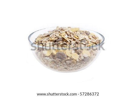 Glass bowl filled with muesli on white with clipping path - stock photo