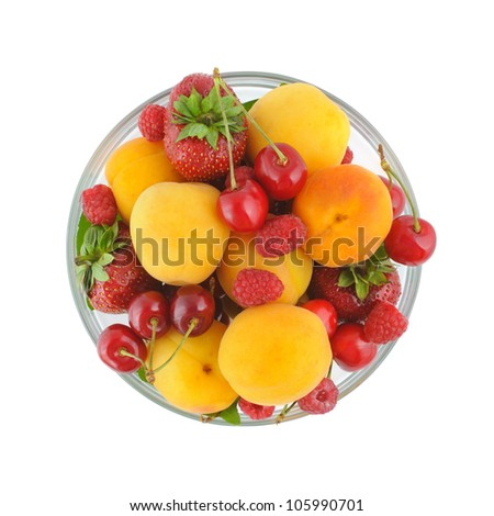 Glass bowl full of a variety of fresh berries. Top view, isolated on white with clipping path. - stock photo
