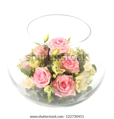 Glass bowl full with pink roses - stock photo