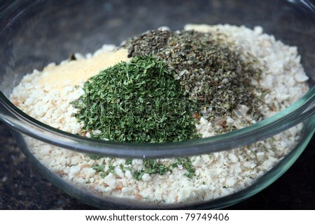 Glass Bowl of Bread Crumbs and Seasoning Ingredients - stock photo