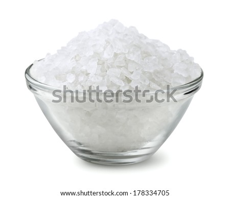 Glass bowl of salt isolated on white - stock photo