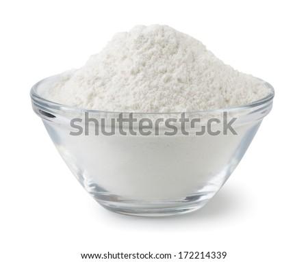 Glass bowl of wheat flour isolated on white - stock photo
