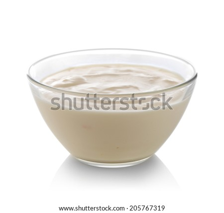 Glass bowl of yogurt isolated on white - stock photo