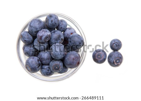 Glass bowl with blueberries on white background top view - stock photo