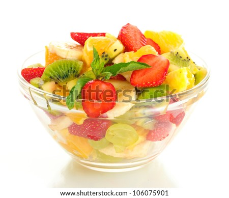 glass bowl with fresh fruits salad isolated on white - stock photo