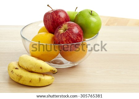 Glass bowl with fruit for diet on the wood table - stock photo