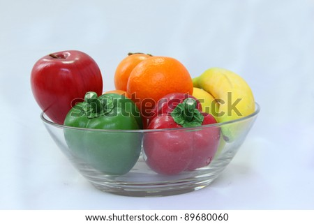 Glass bowl with fruit (isolated on white)