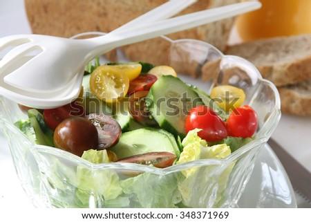 Glass bowl with season salad - stock photo