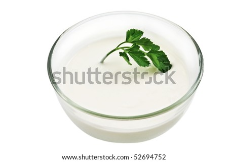 Glass bowl with sour cream and parsley - stock photo